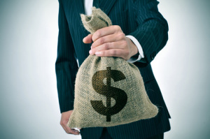 businessman with a burlap money bag