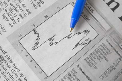 Pen showing graph on financial report