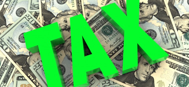 Green tax word on twenty dollar background